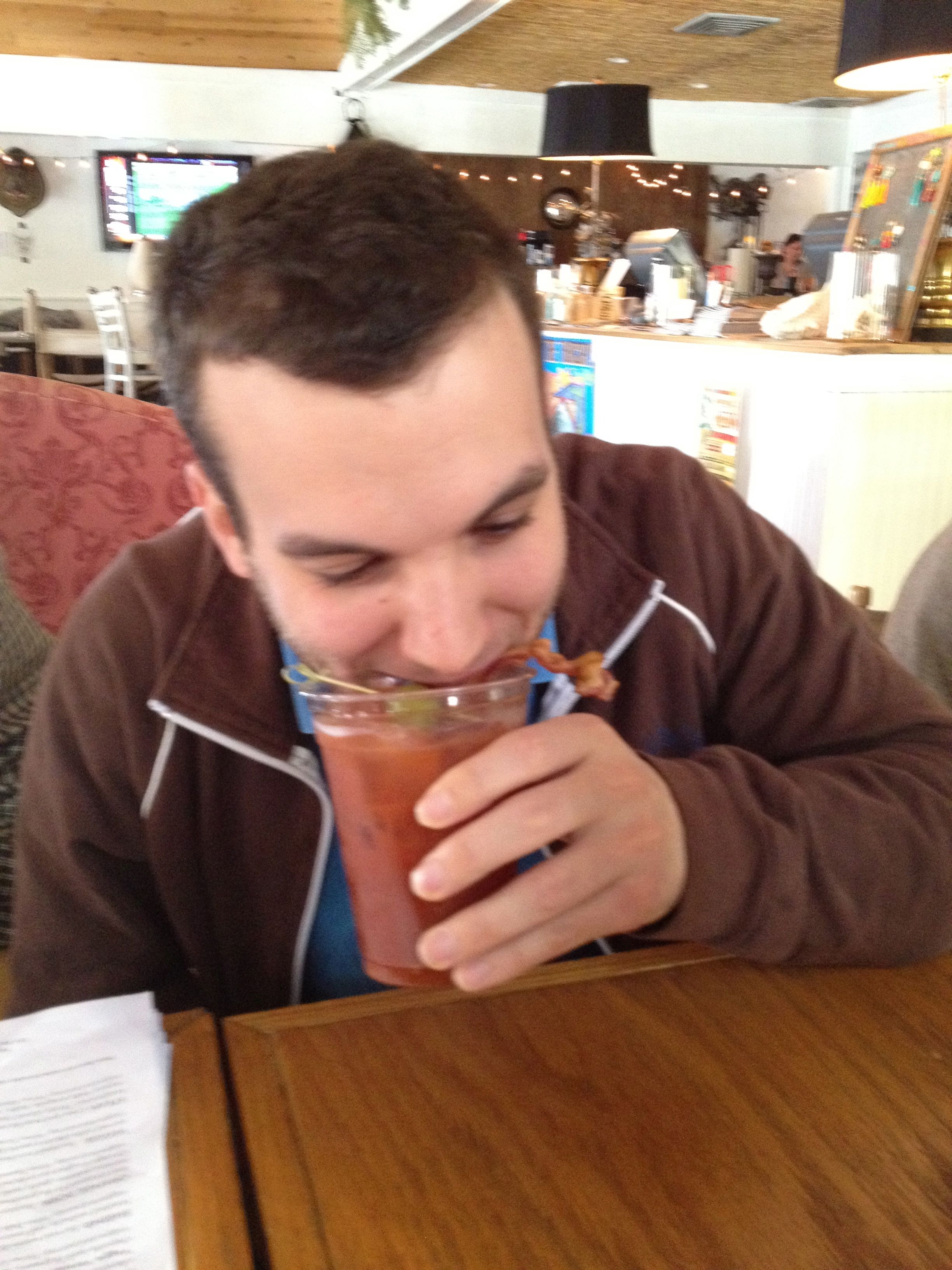 Nacin attempting to consume a bacon bloody mary
